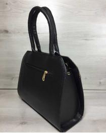 Женская сумка Конверт черного цвета со кофейная реплилия