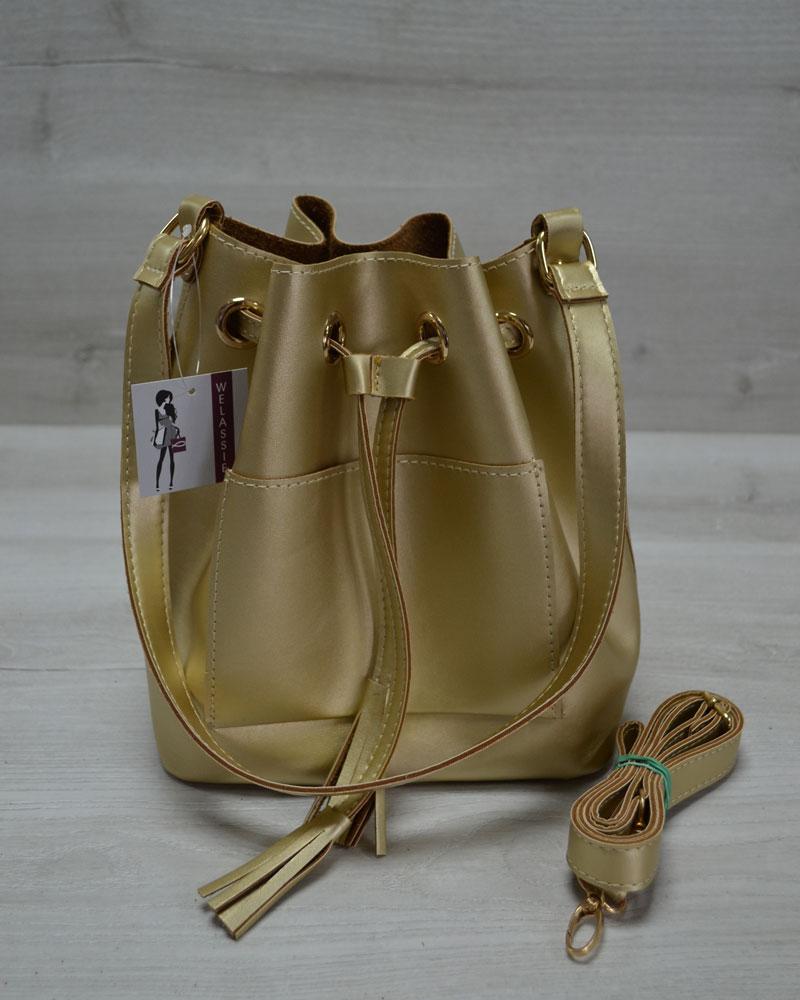 Молодежная сумка из эко-кожи  Люверс  золотого цвета
